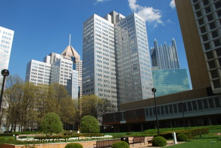 A Downtown office part with lots of metallic buildings -- Pittsburgh is steel city and its downtown architecture shows it