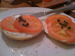 My bagel with cream cheese, tomato and capers