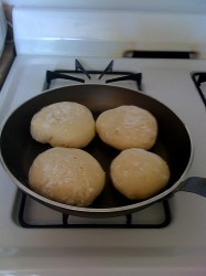 English muffins cooking on the stove