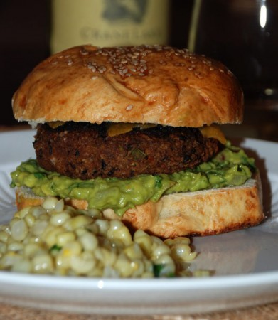 Black bean veggie burger on a homemade bun with corn on the side