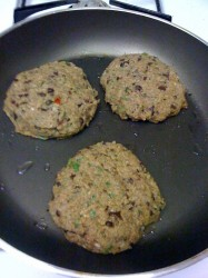 cooking the veggie burgers in a pan